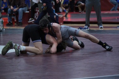 Tucker Cochrane (106, in gray) faces off against a wrestler from Rumson-Fair Haven at Saturday's Buc Classic.